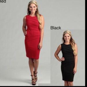 Calvin Klein black sunburst body con dress